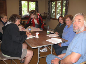 Six participants siting at a table.