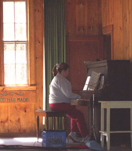 Photo of Alisa playing the piano