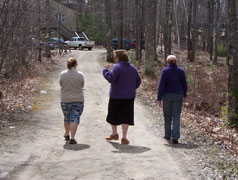 Photo of Carolyn, Marcy and Judith walking down the drive way (away from the camera).