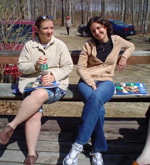 Photo of Carolyn and Mariana sitting on a bench outside