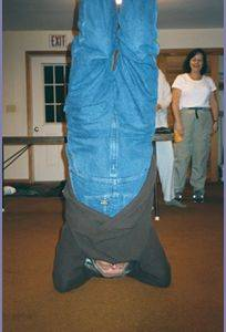 Photo of George doing a headstand