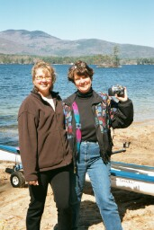 Photo of Ginger and Romayne standing in font of the lake.