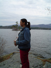 Photo of Jackie outside, standing by the lake