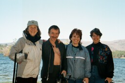 Photo of Jane, Chris, Joanna and Romayne standing in front of the lake.