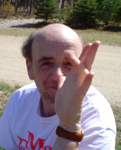 Close up photo of Jim M with his thumb on nose, hand extended toward the camera