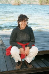 Photo of Judith in front of the lake.