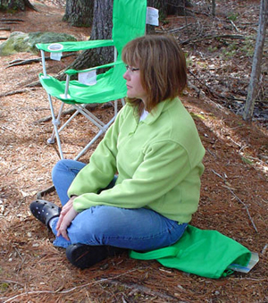 Photo of Kelly sitting on the ground
