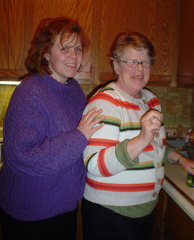 Photo of Marcy and Mom smiling, inside.