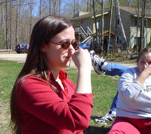 Photo of Stefanie and Alisa sitting outside, touching their noses